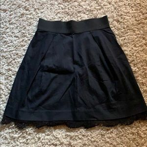 black skirt from elle with lace at the bottom